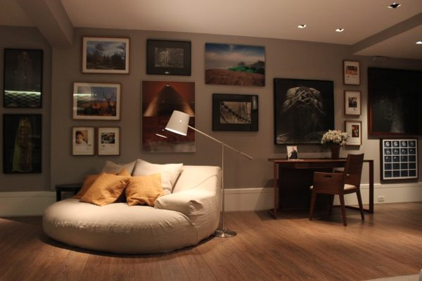 Paintings and a Stylish Sofa Bed