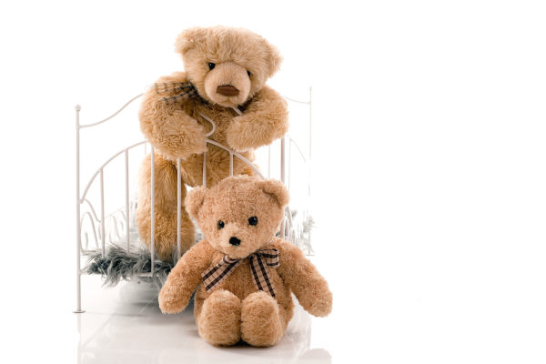 Teddy Bears and a Miniature Bed Frame